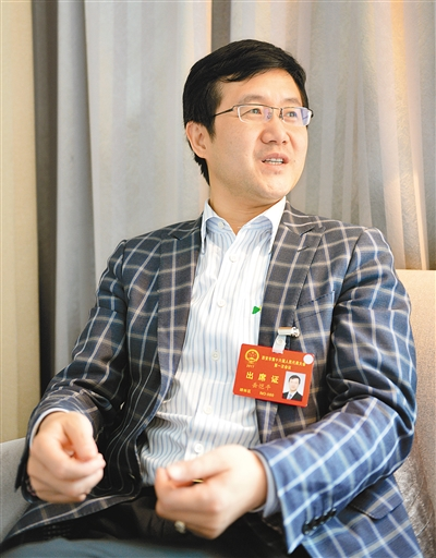 《西安日报》采访人大代表岳恺平:推广互联网易货模式,增强经济活力!